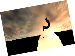 man in silhouette jumping across a chasm